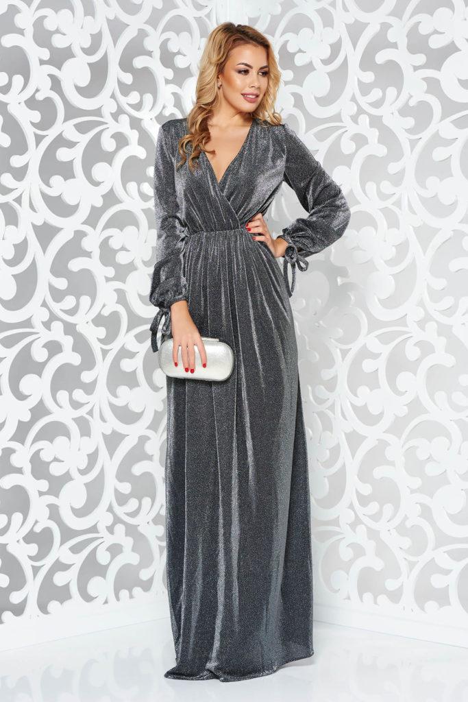 Rochie lunga de seara argintie pentru Revelion din tesatura metalica cu fir lurex si manecile lungi legate cu panglici la capete