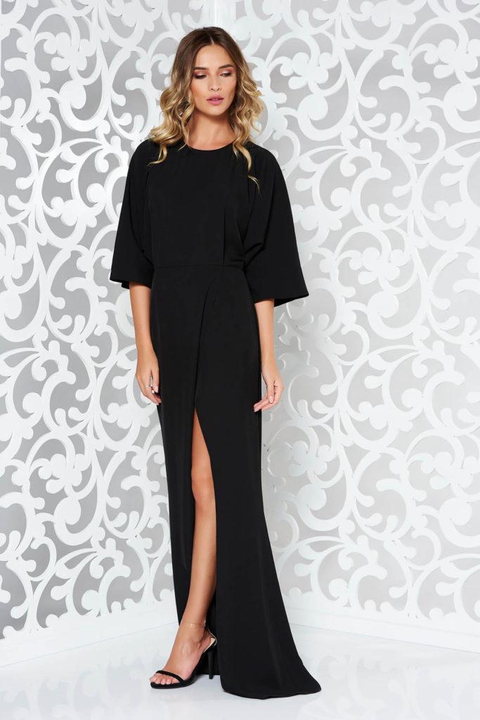 Rochie lunga pana in pamant neagra cu spatele decupat si crapatura pe picior din material tip voal fluid usor transparent